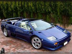 A magnificent blue metallic Lamborghini Diablo SV Roadster, this is actually a rare RHD version.