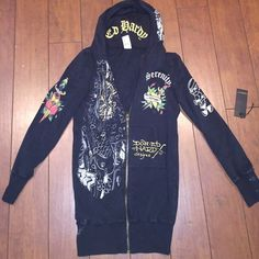 Extra long Ed Hardy zip up jacket Original Ed Hardy long jacket with cool designs on the front, hood, back, and sleeves. Size S, gently worn Ed Hardy Jackets & Coats