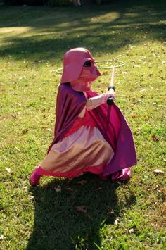 This is the awesomest kid ever.  Why didn't I think of being a Darth Vader Princess for Halloween?