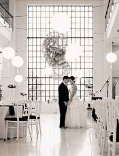Black and white wedding in our triple volume foyer at the forum | the campus. Chinese lanterns strung across the space work effectively with the high ceiling.