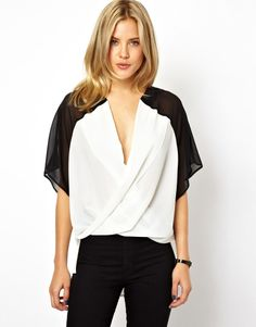 ASOS Top with Inserted Collar in Sheer and Solid Color Block Top by ASOS Collection Made from a woven poly fabric. Draped wrap front. Sheer and solid colourblock design. Regular fit.