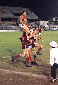 Shaun Smith marks for Melbourne against the Brisbane Lions at the Gabba in round 22, 1995.