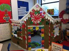 Gorgeous Gingerbread Dramatic Play House... IDEA: velcrow all the trimmings so that you can change it every season and keep all year long!