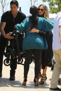 Pin for Later: New Moms Chrissy Teigen and Kim Kardashian Share a Sweet Hug in LA
