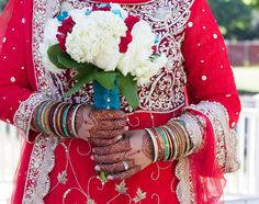Indian/Pakistani/Fijian/American bride with red lehenga, bouquet, bridal mehndi and jewelry. Wedding colors- red, white and turquoise blue