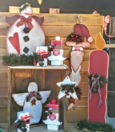 My items/part of my display during a show in Scottsdale AZ... Briar Patch Market place. Wood crafts, country, rustic and primitive. Wooden Christmas angels, snowman angel, block shelf sitter Santa with burlap, long beard rustic Santa with Christmas floral, Christmas star with rusted bells. Block shelf sitter snowman and large wooden Christmas candle with lg rusted bells. Country primitive wood crafts. :)