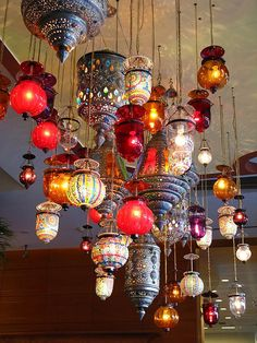 Gorgeous Moroccan lanterns - great idea for the living room, or could be used as hanging table centerpieces.