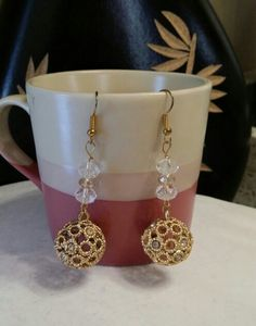 Gold bling open circles balls with clear roundell beads.