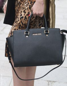 On the street at fashion week: leopard is a smokin' backdrop for the MICHAEL Michael Kors Selma top handle bag