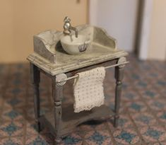 I am still occupied with painting and making imitated marble. Made this wash table last night, and added a porcelain sink, a faucet a...