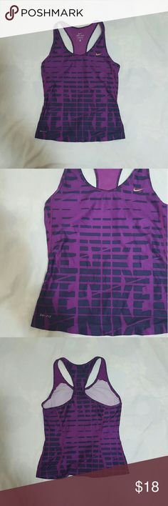 Nike Dri-Fit Women's Tank Purple Medium racerback Nike women's dri-fit tank racerback. Size Medium. Purple. In used condition. There is a small hole on the back- see pictures. A812 Nike Tops Tank Tops