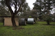 A wide angle of the side of her property. The shed (which includes the stereotypical Australian 'Dunny') and upturned water tanks can be seen. Does not provide answers to the viewer of the series, and therefore is not needed within the final.