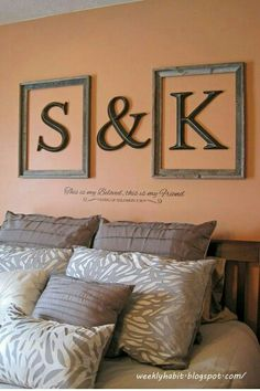 I love the framed letters above the bed.