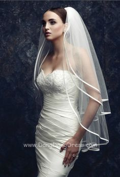 This kind of looks like my dress...hmm interesting veil, I kind of like it!