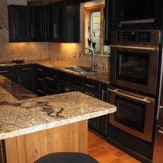 Kitchen Design Ideas, Pictures, Remodeling and Decor - I love black cabnets, stainless steel and earth tones in my kitchen...*sigh* some day