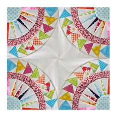 love, love, love!!  looks like a mariner's compass with a circle of geese bordering it.  I get the feeling that piecing this block would drive me to drink... But it's goooorgeous.