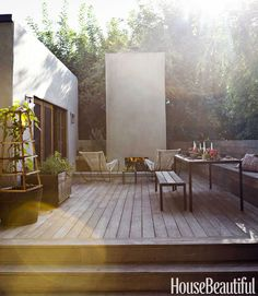 Blackman Cruz chairs are drawn up to a fireplace, which adds warmth to the dining area. Table from Ten 10 gallery. Read the full interview with Pamela.   - HouseBeautiful.com