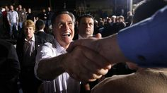 3/4/2012 March 3, 2012: Mitt Romney greets supporters at a town hall meeting in Dayton, Ohio. (AP)