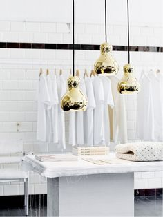 nice the gold lamps with the white surroundings and just a small black line