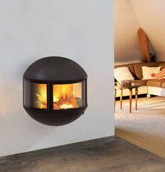 For the master bedroom- contemporary wall-mounted fireplace (wood-burning closed hearth) - EDOFOCUS D.A - ArchiExpo