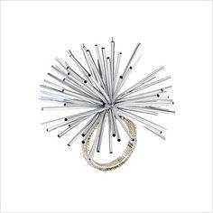 Kim Seybert Atomic Silver Napkin Ring (Set of 4): Wrapped with amber-colored beads, Kim Seybert's Atomic napkin ring is topped with a burst of silver tubes. 1.5