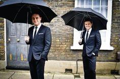 "u-krazy-katz: "" Big enough umbrellas! "" They should do dancing in the rain."