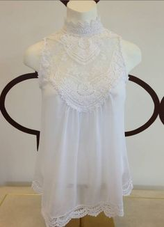 LACED HIGH NECK SLEEVELESS TOP IVORY $68- CALL SPLASH TO ORDER 314-721-6442