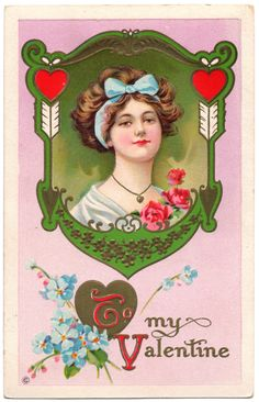 This is a lovely Edwardian era Valentines Day postcard. It's embossed and pictures a Gibson Girl style woman framed in and Art Nouveau borde...