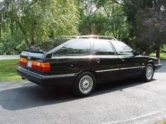 The Audi thing was good, and the white wagon was replaced with a black one, and one year newer with a real increase in power. 5-speed, 20V turbo, AWD, Black and some sporty wheels.  It's was not over the top, just a perfect old school sleeper wagon.  1991 Audi 200QV Turbo Avant.