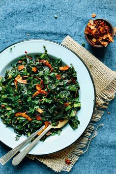 Easy 20-minute, 1-pan collard greens with coconut bacon for a smoky, crispy crunch! A delicious, healthy, plant-based side dish or snack.