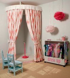 Love the stage with curtain and storage cabinet on wheels for dress up clothes....i wish i had this room when i was younger!