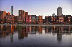 Professional Print.  Sizes: 10 X 8 inches and 19 X 13 inches.  This picture was taken early in 2016.  As you can see, part of the Boston Esplanade by the Charles River was starting to freeze over.  I love the way the towers rise above the brick buildings in the forefront.  Great place to catch a sunset!  IG: @burnsobright11 website: www.burnsobright.com