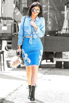 Why You Need A Denim Pencil Skirt, Courtesy Of Kylie Jenner #refinery29  http://www.refinery29.com/2015/04/84924/kylie-jenner-denim-pencil-skirt#slide-1  Kylie Jenner was photographed in Los Angeles wearing a denim pencil skirt and matching button-up knotted at her waist.