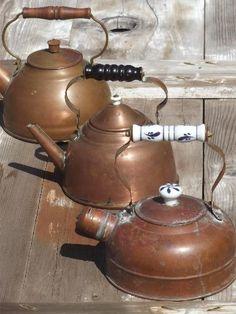 collection of vintage copper kettles, whistling tea kettle & teapots