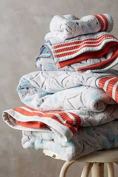 Anthropologie EU Ameera Printed Towel Set. This Ameera printed wash cloth gives your home textiles an instant stamp of character. Great for bathrooms, kitchens and basins; this towel sports an all over star and circle print, finished with vibrant red stripes at the edges.