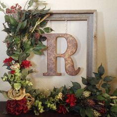 Brand new to Sunburst Outdoor Decor!  Decorate your front door or a wall inside your home with this beautiful rustic floral monogram wreath.