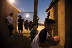 Kids playing at a Taos softball game