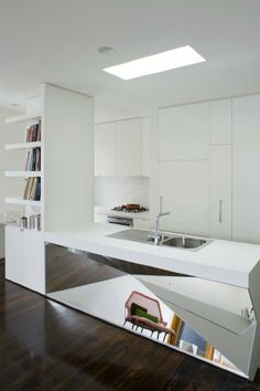 rectangular-shaped and that faceted, mirrored kitchen island is a geometric dream that adds a load of personality to a space