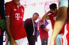 Head coach Carlo Ancelotti of Bayern Muenchen looks on with his players at the players tunnel prior to the Bundesliga match between Bayern Muenchen...