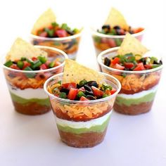 Cinco De Mayo party snack, 7 layer dip. Perfect single serving side dish for a buffet, pair with a small bag of chips