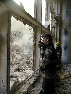 Two Firefighters Look Out On The Remains of World Trade Tower N and World Trade Tower S.
