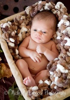 I think this little one is contemplating the meaning of the universe! Baby Blanket Newborn Photography Prop Popcorn Blanket with Pom Poms! $65