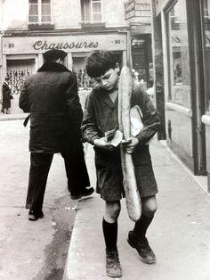 Va chercher le pain :-)  Enfant au Pain c. 1949 by Doisneau