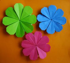 Flower Power!!  I love hippie flowers.  Folding diagrams on this site.