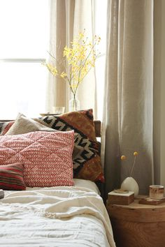 I am normally drawn to much brighter colors, but I'm a little obsessed with the earthy textures in this room. Yum.