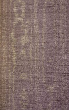 Watered Silk A grape textured vinyl wallcovering imitating silk with a silvery water mark effect.