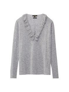 Sweater with ruffle trims. Features a straight fit, V-neckline and long sleeves.