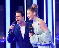 Gigi Hadid Photos - Robbie Amell and Gigi Hadid present at the 2016 iHeartRADIO MuchMusic Video Awards at MuchMusic HQ on June 19, 2016 in Toronto, Canada. - 2016 MuchMusic Video Awards - Show