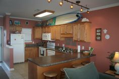 Yes, that is a full size surfboard in the kitchen.