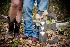 Outdoor country and rustic engagement photo of bride and groom boots with wooden initial letter. Outdoor engagement session on a golf course, rustic, country, chic, by Dallas wedding photographer - Monica Salazar photography http://www.monica-salazar.com